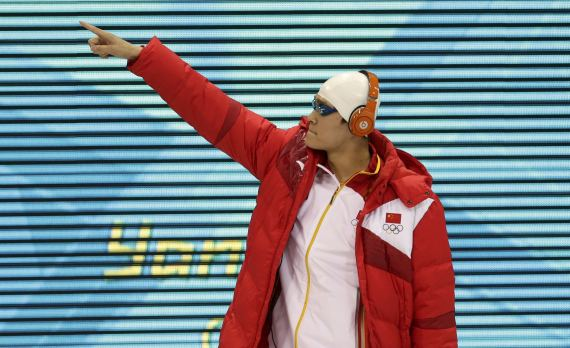 China's Sun Yang aknowledges support from team mates as he arrives for the men's 200m freestyle semi-finals during the London 2012 Olympic Games at the Aquatics Centre
