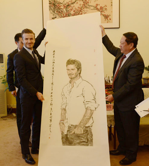 David and An Important Official admire a sketch of Brad Pitt