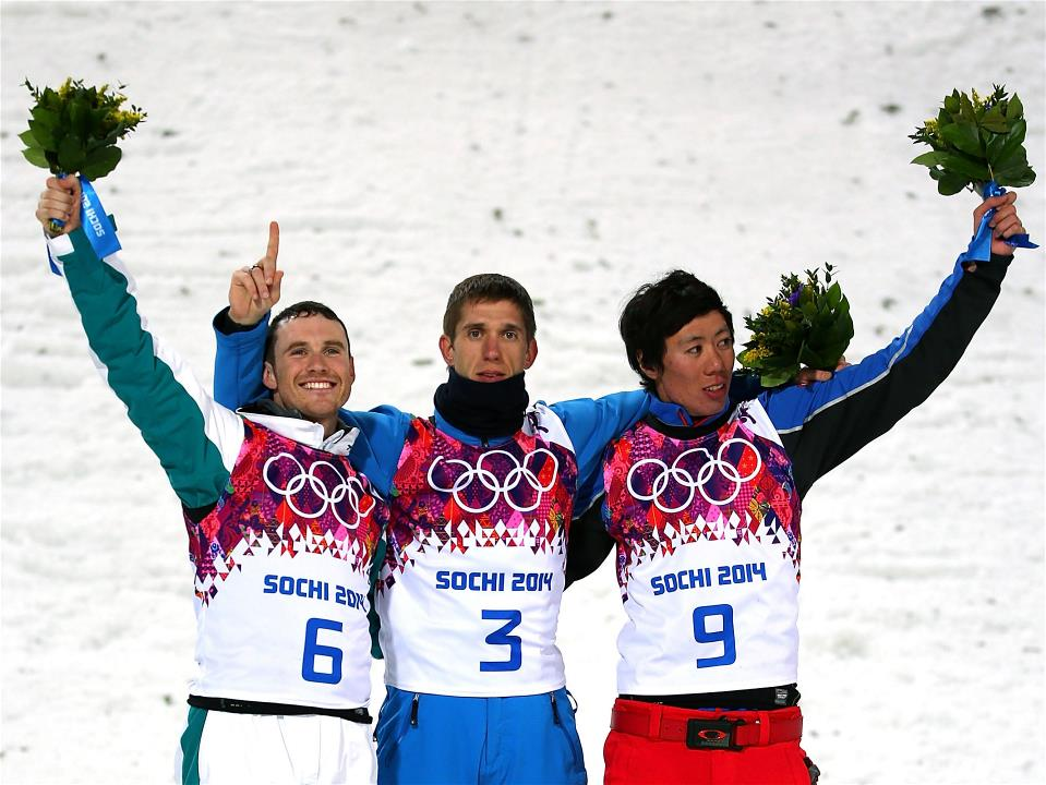 China's Jia Zongyang, right, after winning aerials bronze