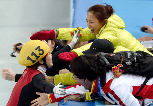 Li Yan (top) celebrates another gold medal