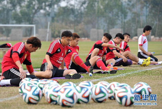 Chinese players prepare to face Iraq in their Asian Cup qualifier on March 5