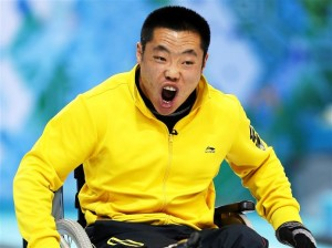 Liu Wei celebrates a rare positive moment on the final day of the curling competition
