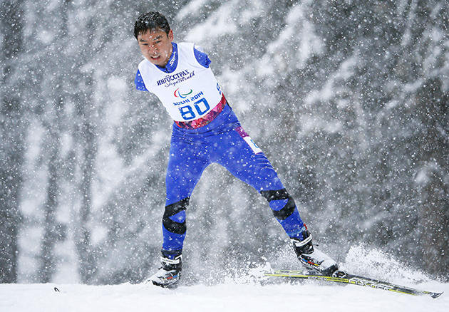 China's Du Haitao helped the cross-country skiing relay team to a 7th place finish