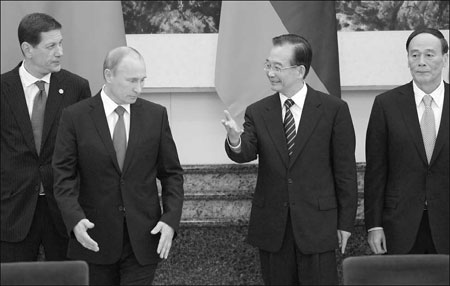 Zhukov and Putin meet then Chinese Premier and Vice Premier Wen Jiabao and Wang Qishan in 2011