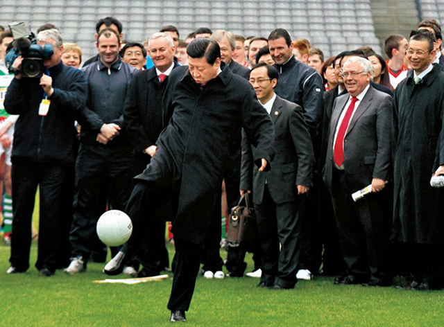 "A full-size picture of the ""soccer"" photo in XI's office"