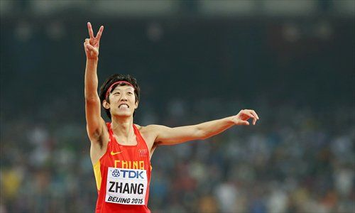 High jumper Zhang Guowei celebrates a silver medal at the 2015 World Champs in Beijing
