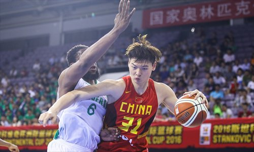 Wang Zhelin in action for China during an Olympic warm-up game vs Nigeria